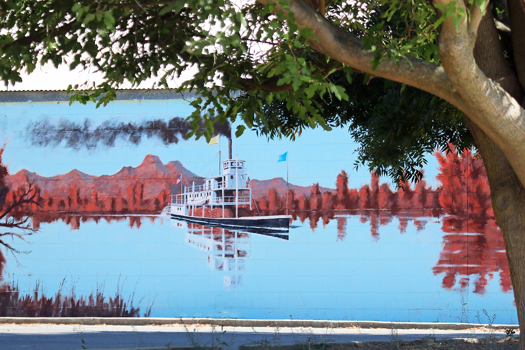 mural of a boat on the river