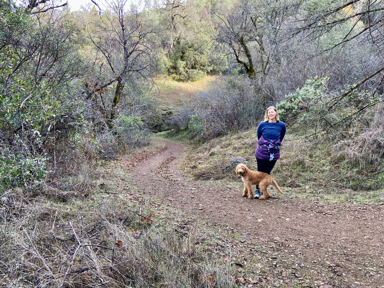 woman and dog on hiking trail