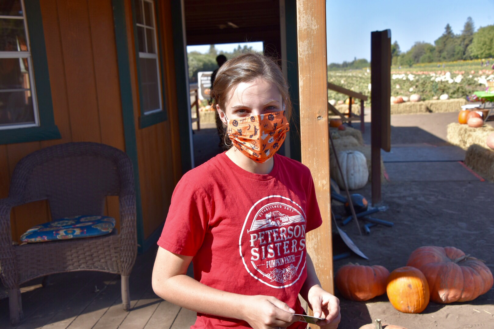 young woman working at pumpkin patch